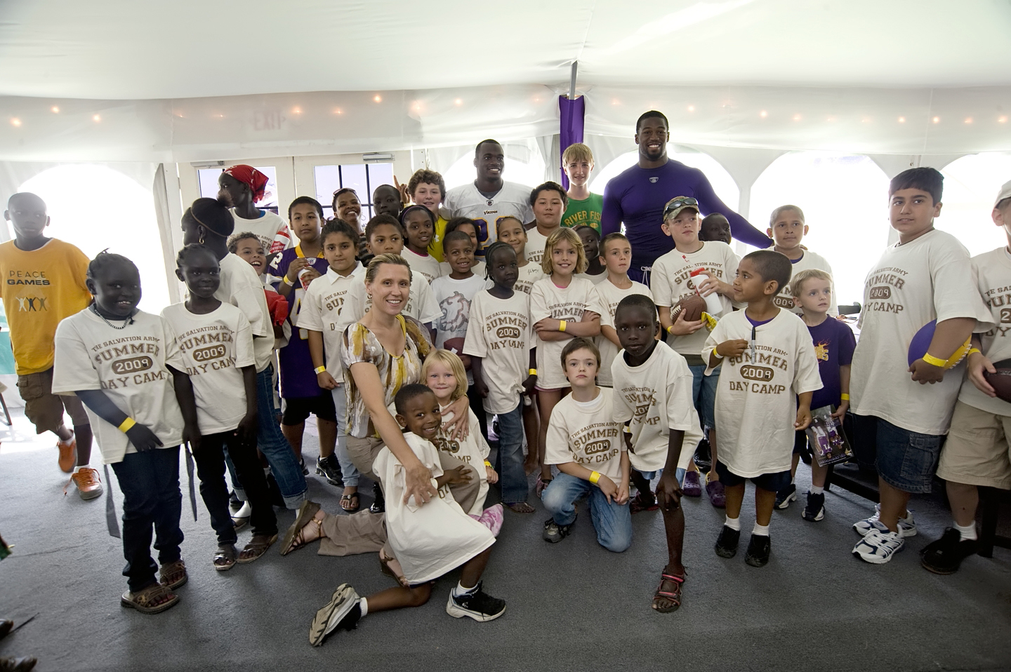 Adrian Peterson and Ray Edwards of the Vikings - with kids